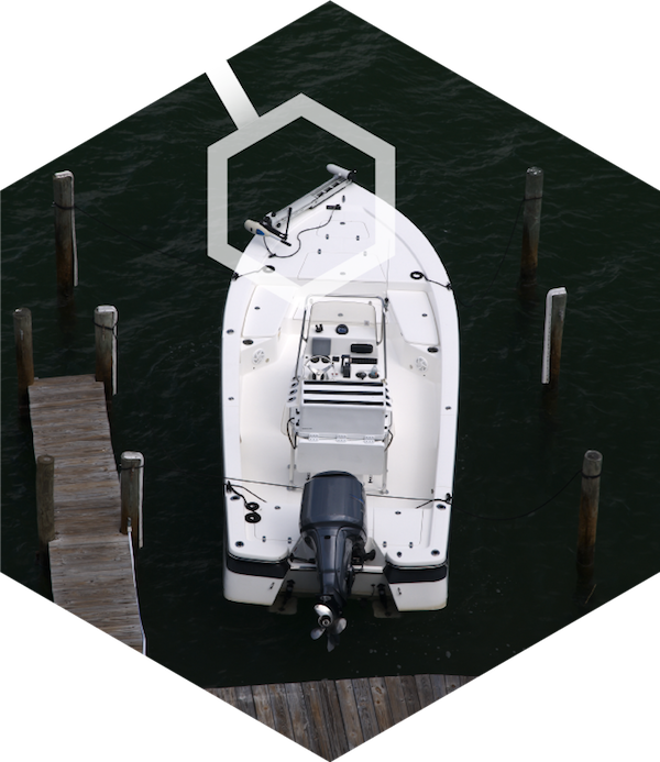 A docked boat with a bow-mounted saltwater trolling motor